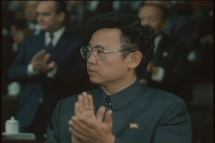 "In this image made from 1980 file television footage, Kim Jong Il applauds while attending the Workers' Party of Korea convention, in Pyongyang, North Korea. The official Korean Central News Agency announced last week the ruling Workers' Party would hold a conference Tuesday, Sept. 28, 2010, to select its ""supreme leadership body."" (AP Photo/APTN)"